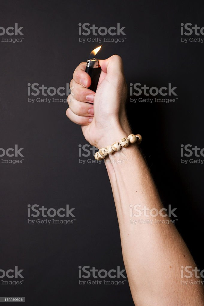 Hand with lighter stock photo