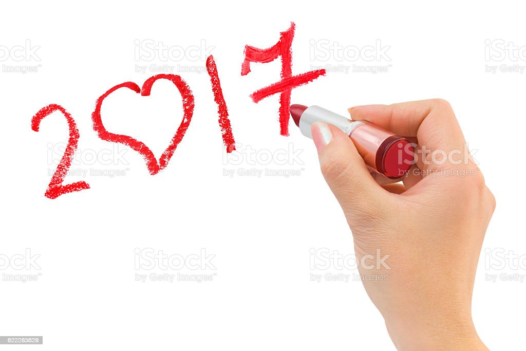 Hand with lipstick drawing 2017 stock photo