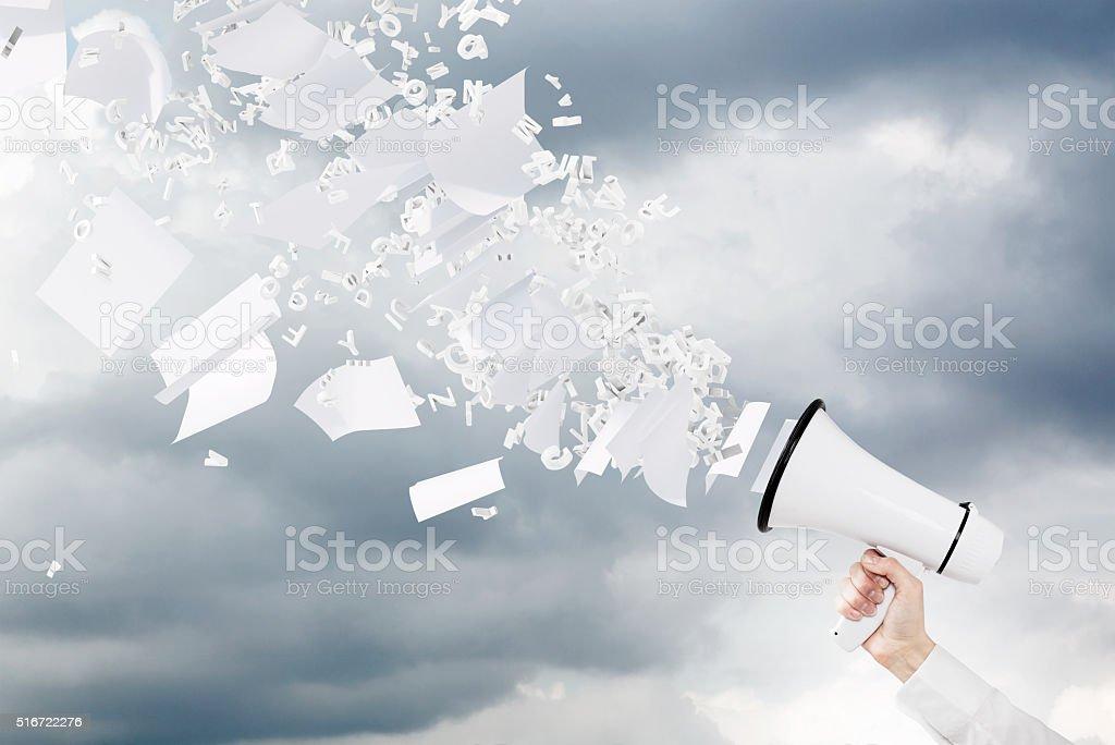 Hand with loudspeaker stock photo