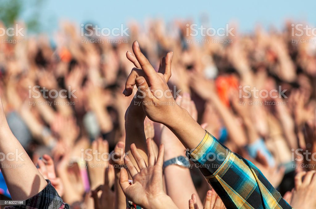 hand with love gesture in festival stock photo