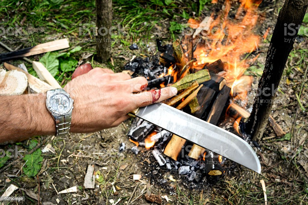 Hand with machete stock photo