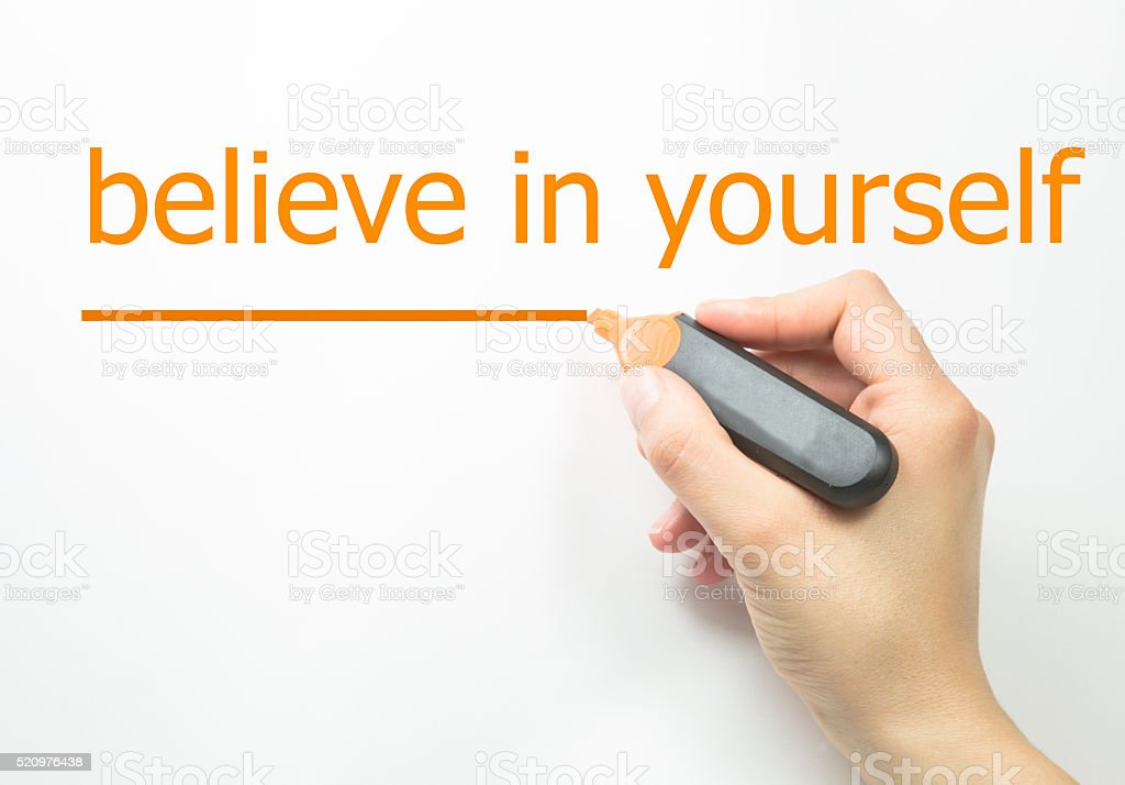 Hand with marker writing: Believe in Yourself stock photo