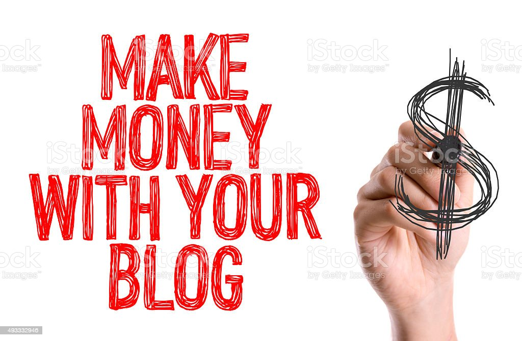 Hand with marker writing: Make Money With Your Blog stock photo