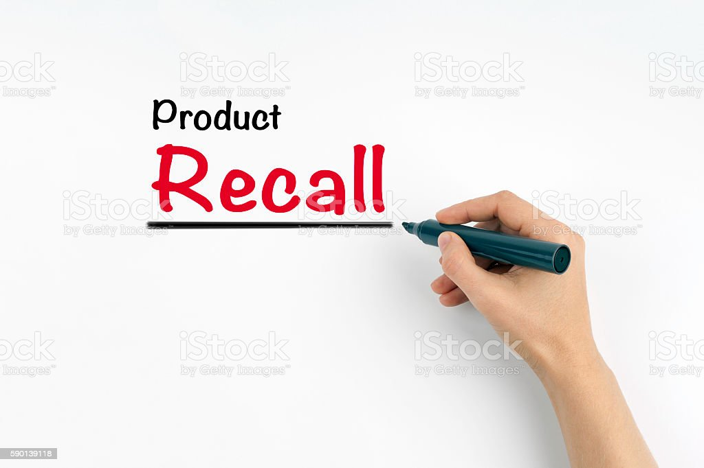 Hand with marker writing - Product Recall stock photo