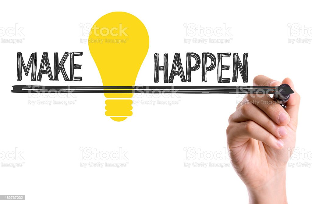 Hand with marker writing the text Make Ideas Happen stock photo