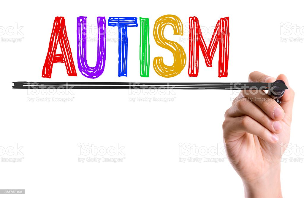 Hand with marker writing the word Autism stock photo