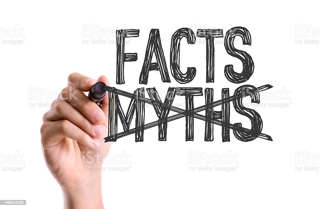 Hand with marker writing the word Facts Myths stock photo