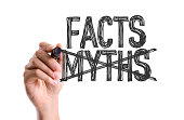 Hand with marker writing the word Facts Myths
