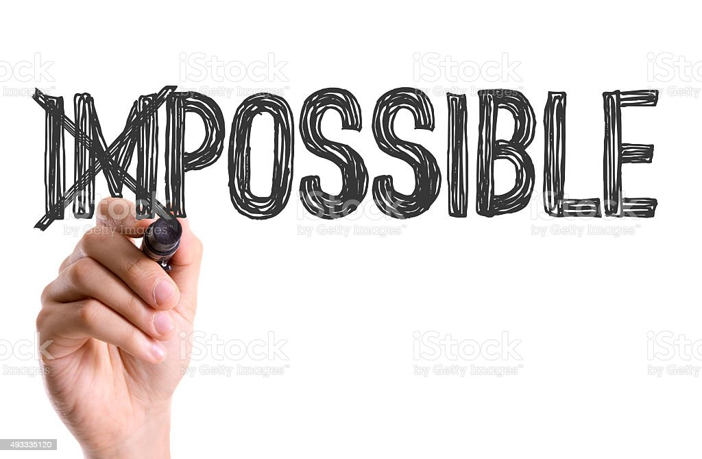 Hand with marker writing the word Impossible/Possible stock photo
