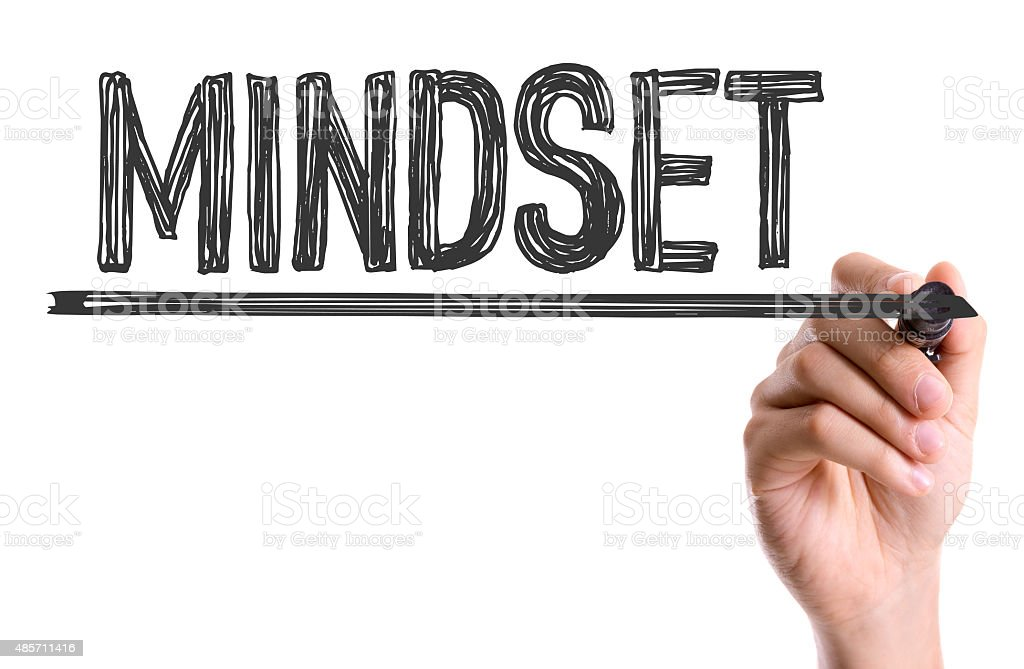 Hand with marker writing the word Mindset stock photo
