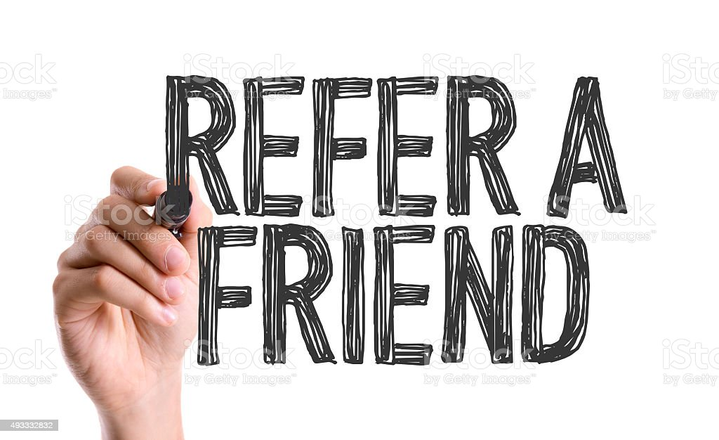 Hand with marker writing the word Refer a Friend stock photo