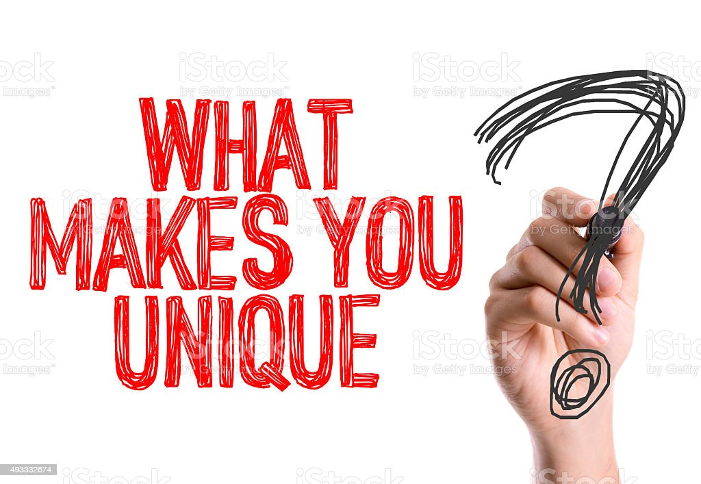 Hand with marker writing: What Makes You Unique? stock photo