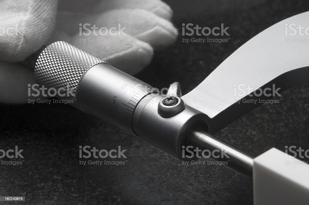 Hand with micrometer stock photo