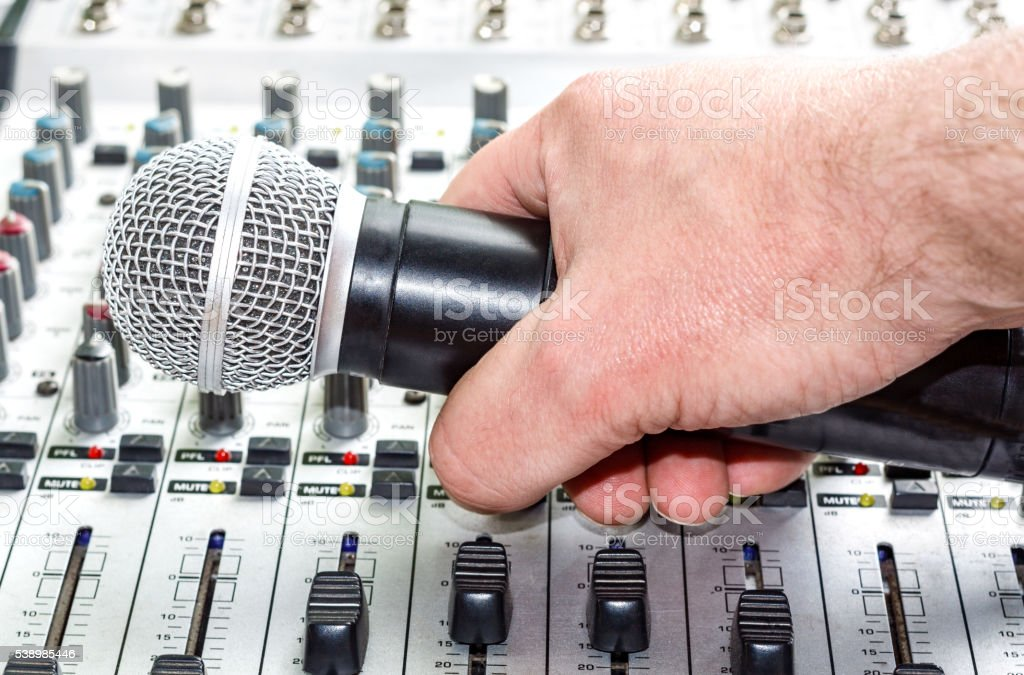 Hand with microphone stock photo