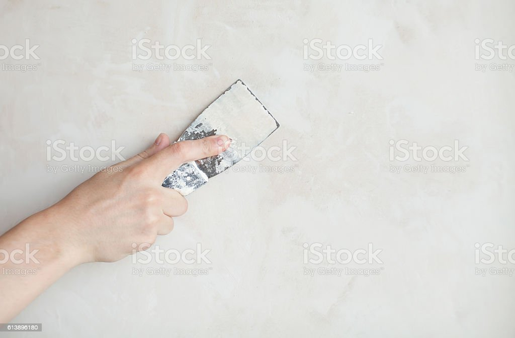hand with palette-knife stock photo
