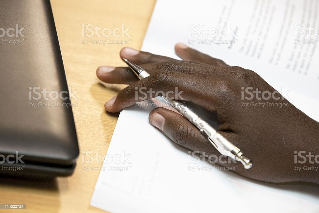 Hand with pen and document stock photo