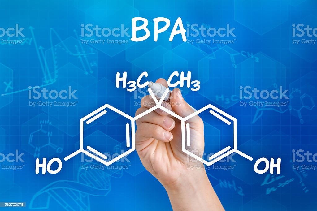 Hand with pen drawing the chemical formula of BPA stock photo