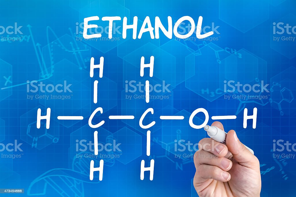 hand with pen drawing the chemical formula of ethanol stock photo