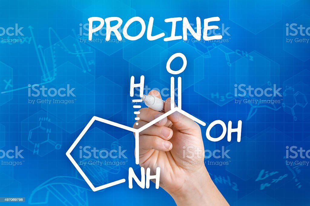 Hand with pen drawing the chemical formula of proline stock photo
