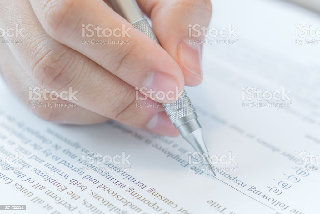 Hand with pen over application form stock photo