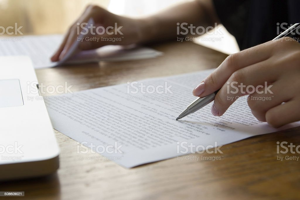 Hand with Pen Proofreading stock photo