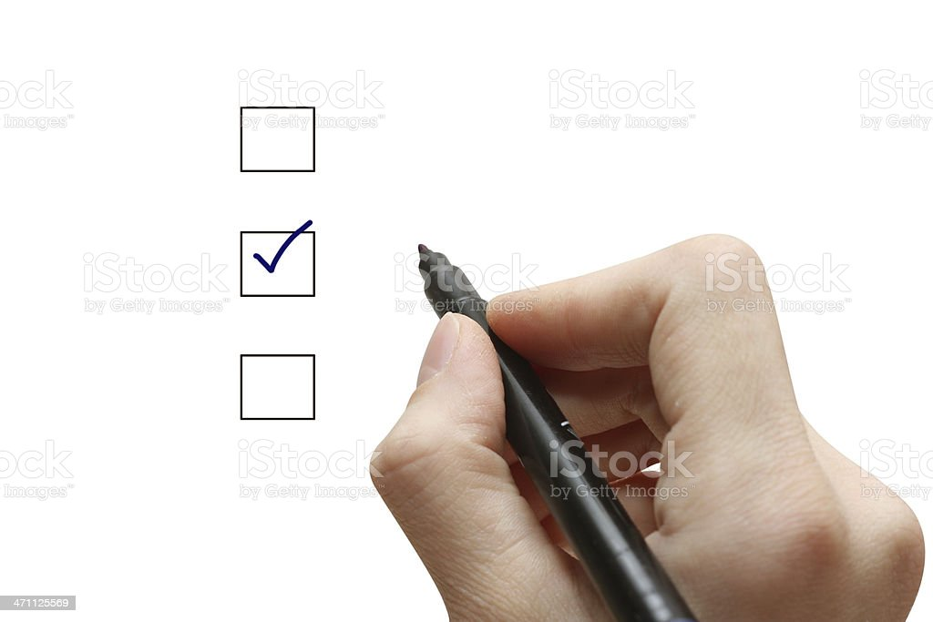 Hand with pen selecting one of three choices with tick stock photo