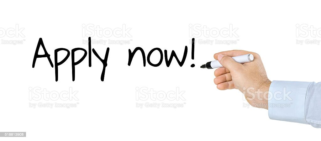 Hand with pen writing Apply now stock photo