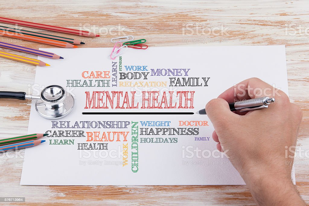Hand with pen writing - Mental Health stock photo