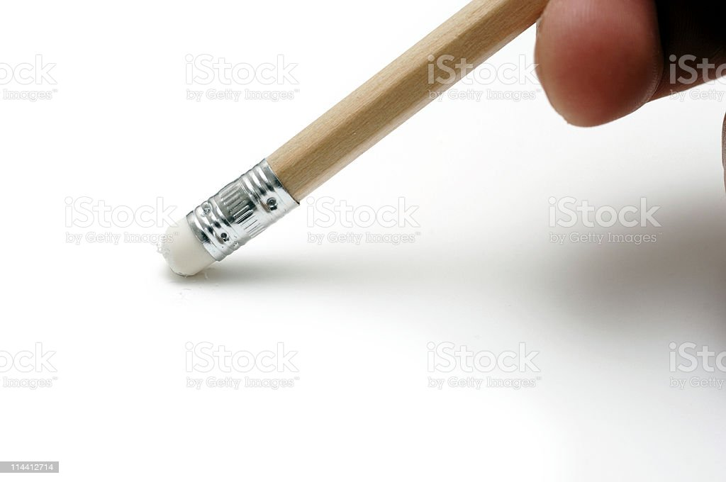 Hand with Pencil eraser rubbing out mistake stock photo