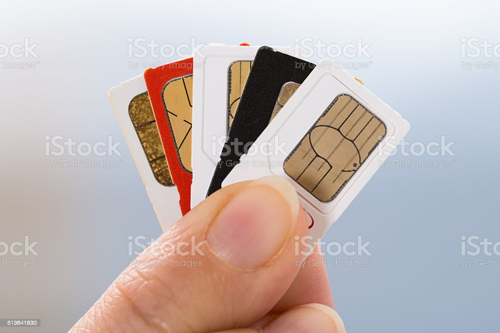 Hand With Phone Sim Cards stock photo