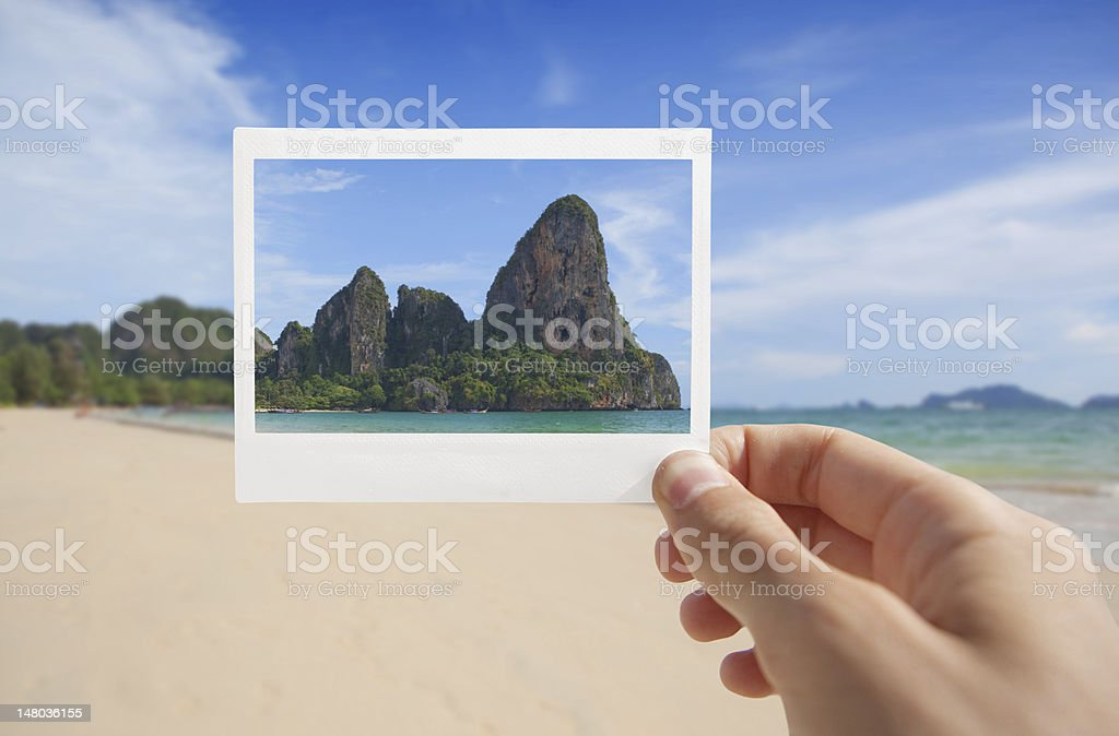 Hand With Photo of Beach stock photo