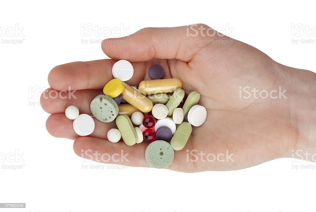 Hand with pills stock photo