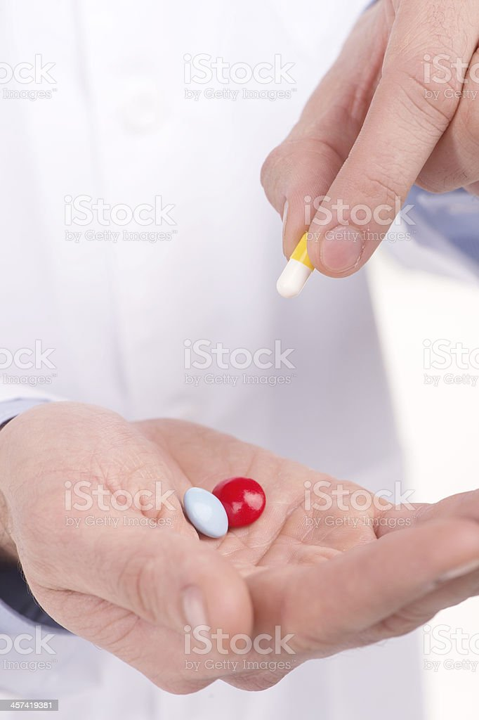 Hand with pills. royalty-free stock photo