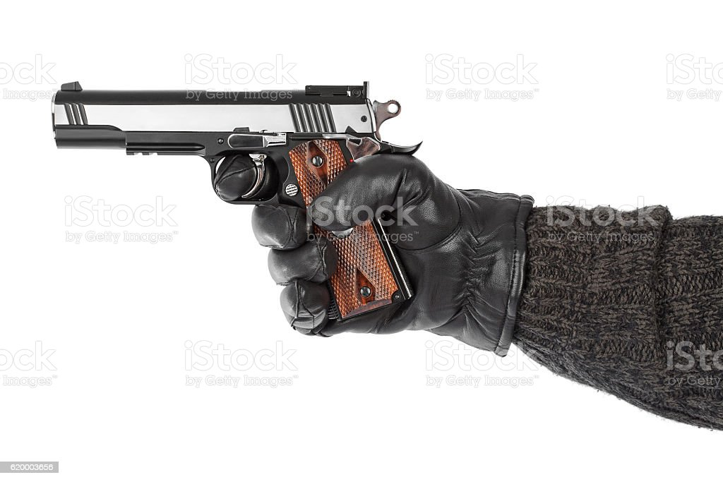 Hand with pistol stock photo