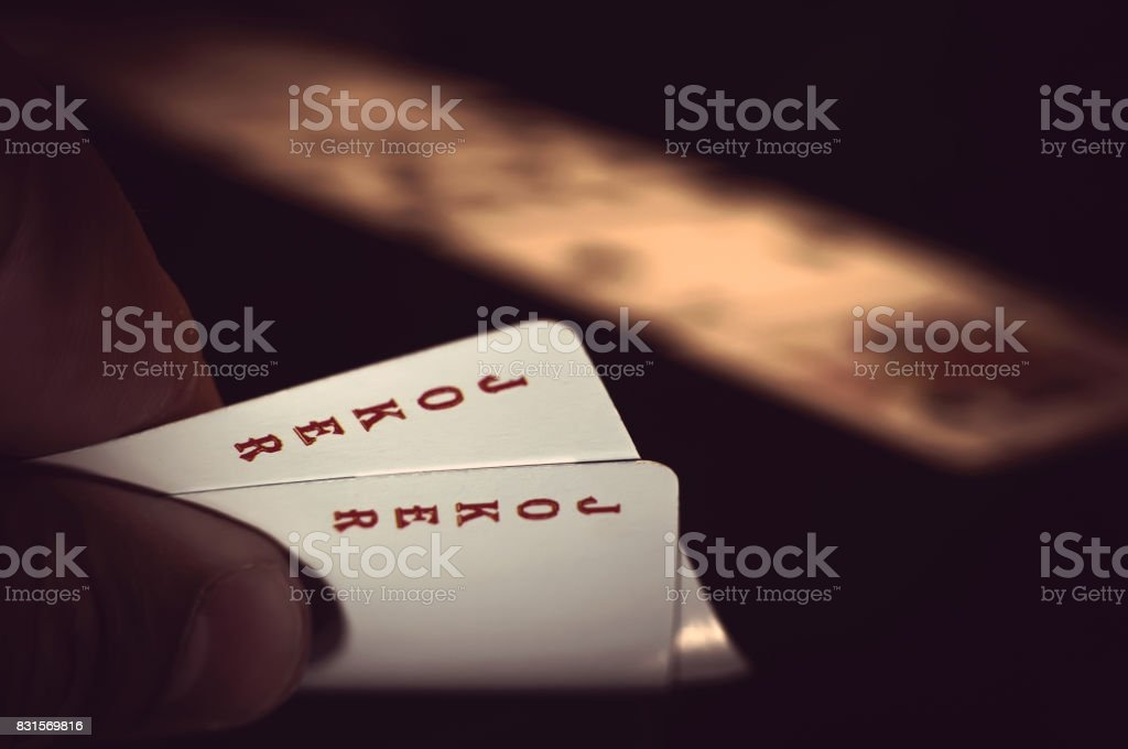 Hand with playing cards stock photo