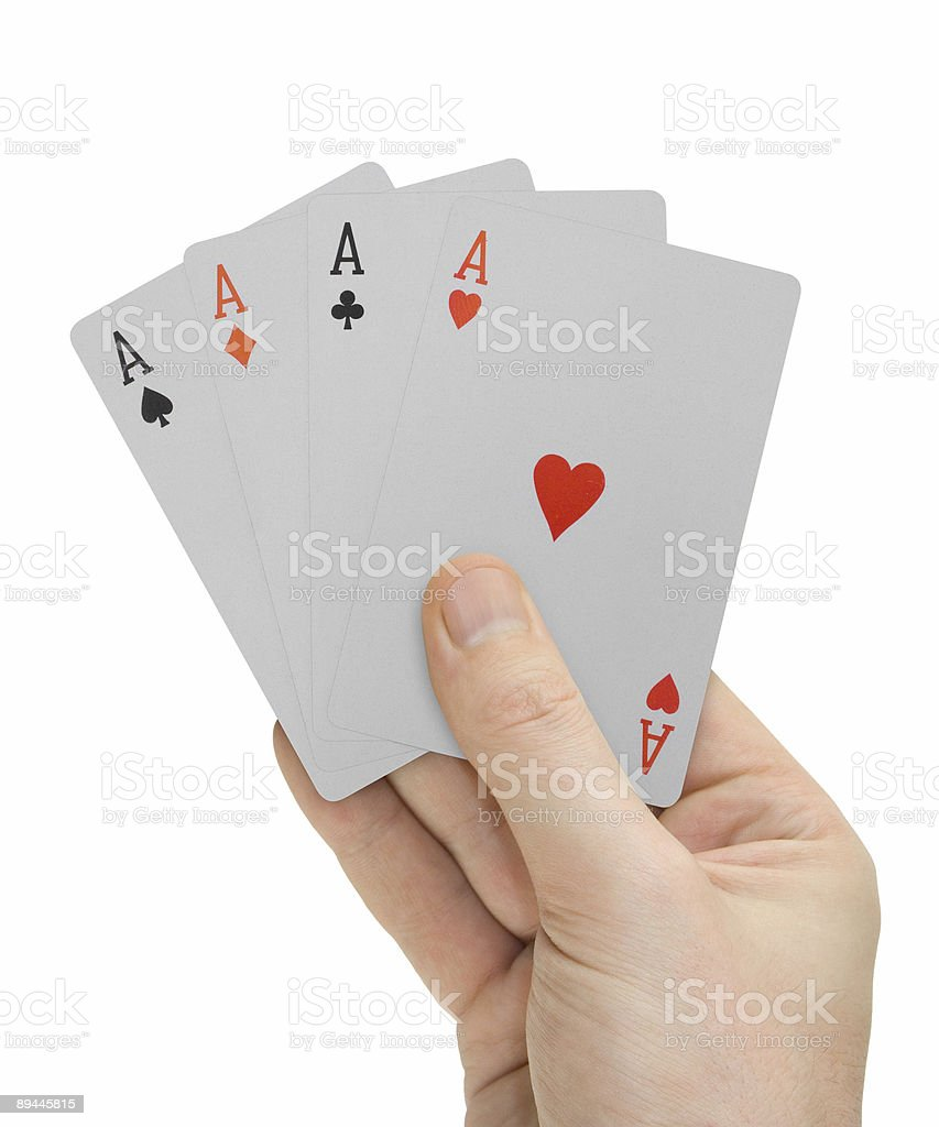 Hand with playing cards (four Aces) stock photo