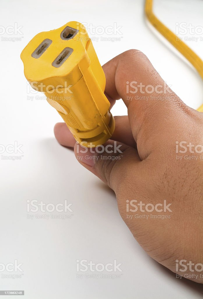 Hand with plug royalty-free stock photo