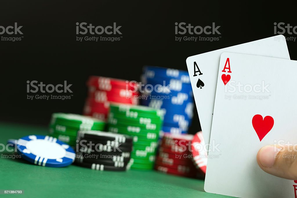 Hand with poker aces stock photo