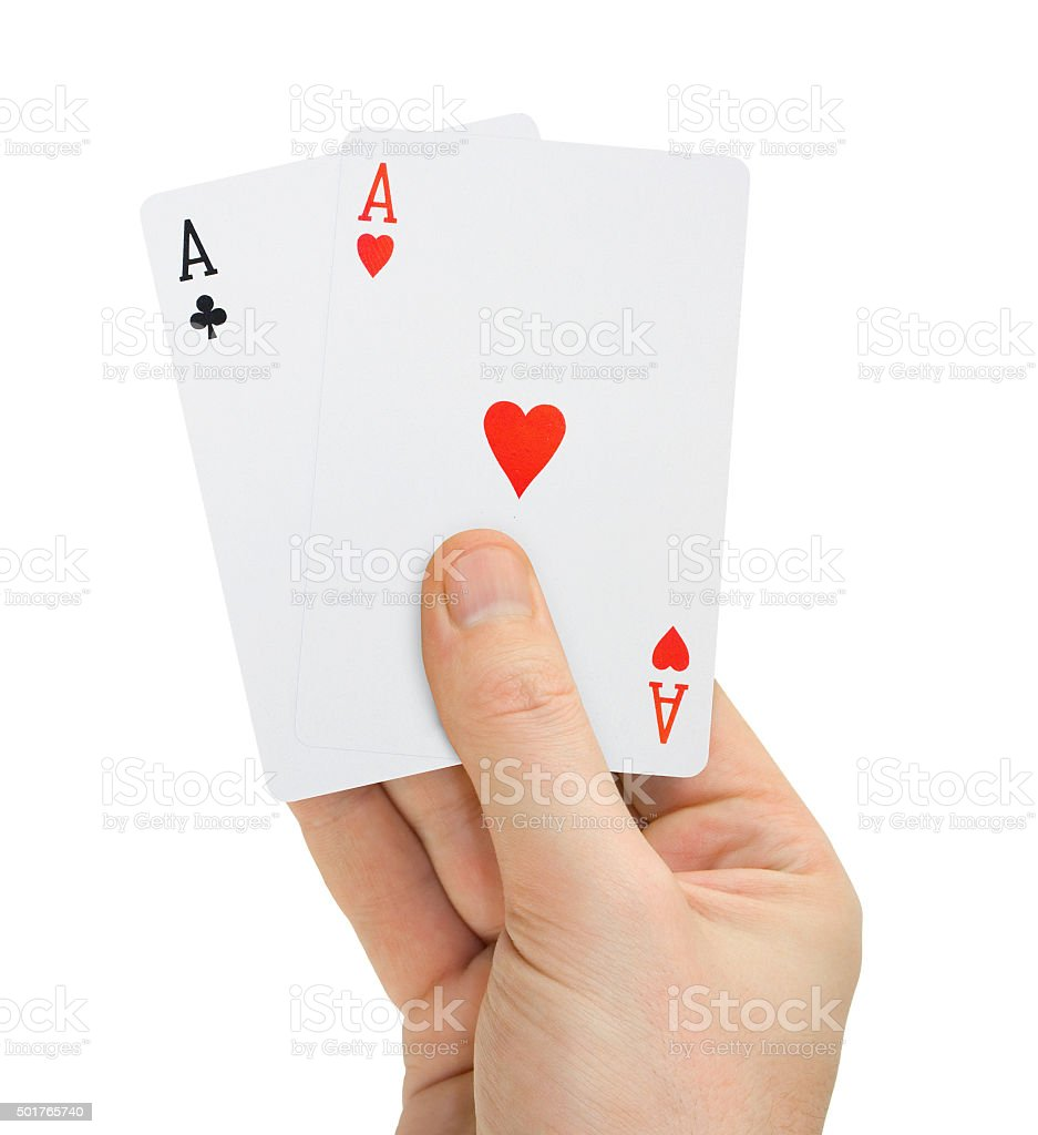 Hand with poker cards stock photo