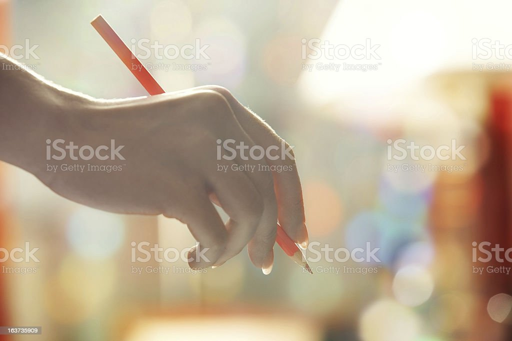 Hand with red pencil royalty-free stock photo