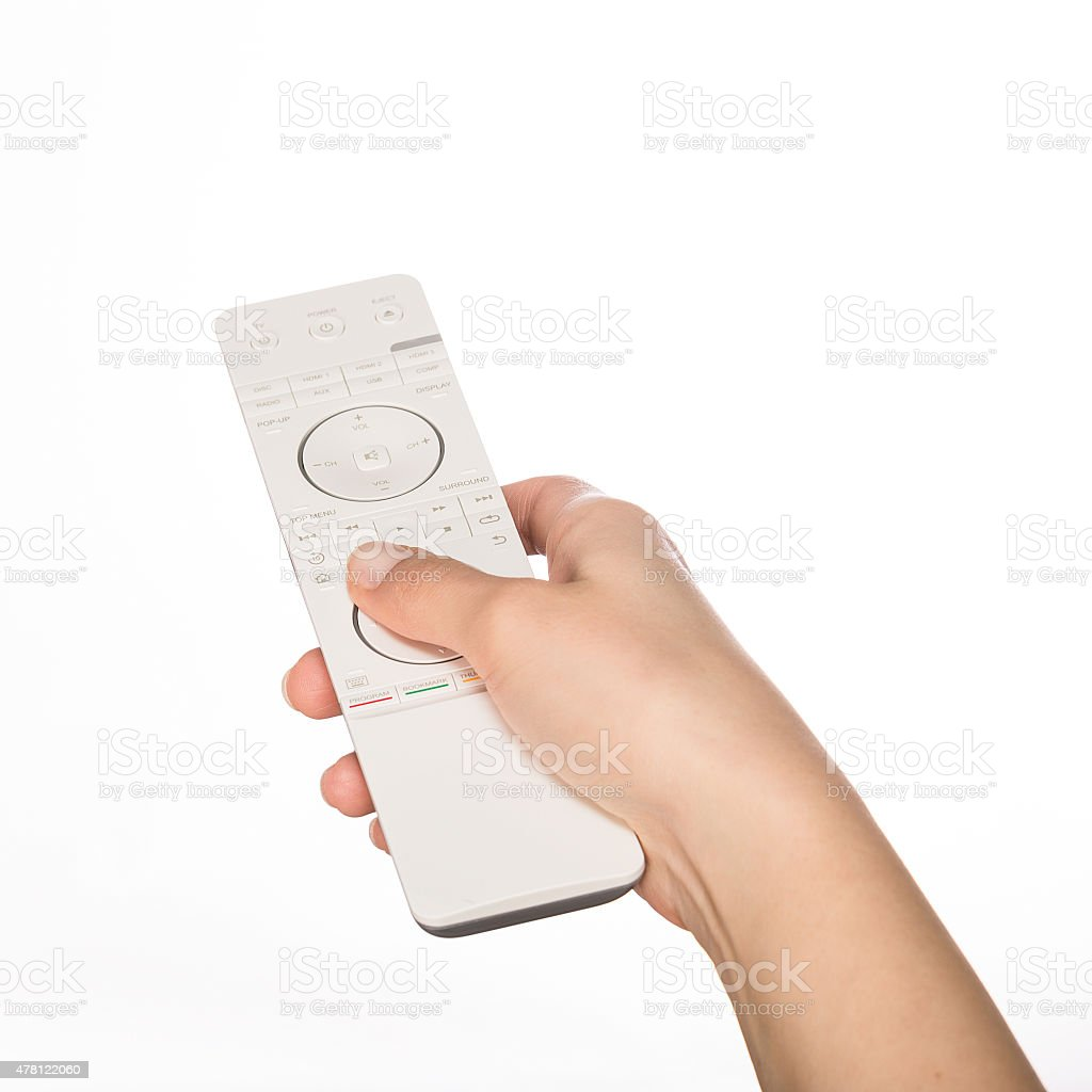 Hand with remote control. stock photo