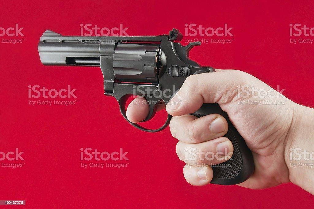 hand with revolver stock photo
