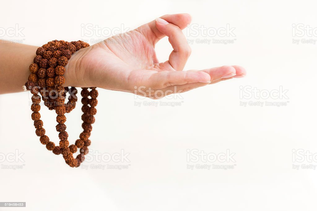 Hand with rosary in meditation  mudra, selective focus stock photo