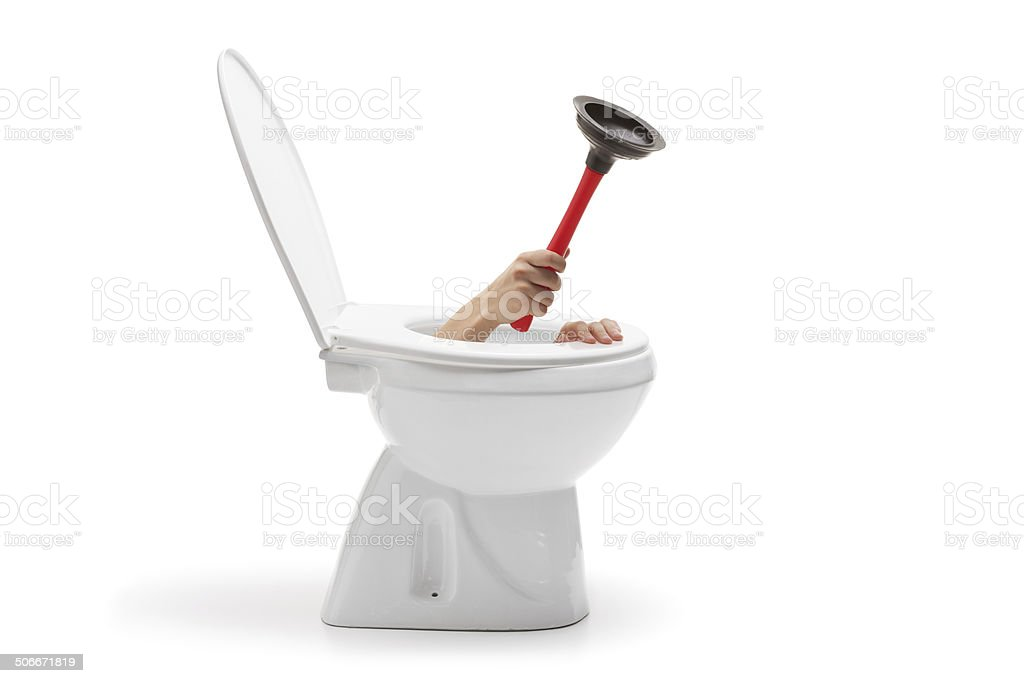 Hand with rubber suction cup coming out from toilet bowl stock photo
