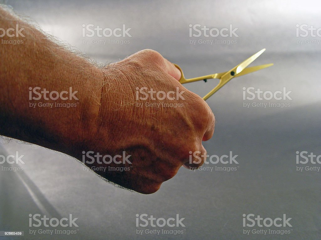 Hand with scissors royalty-free stock photo