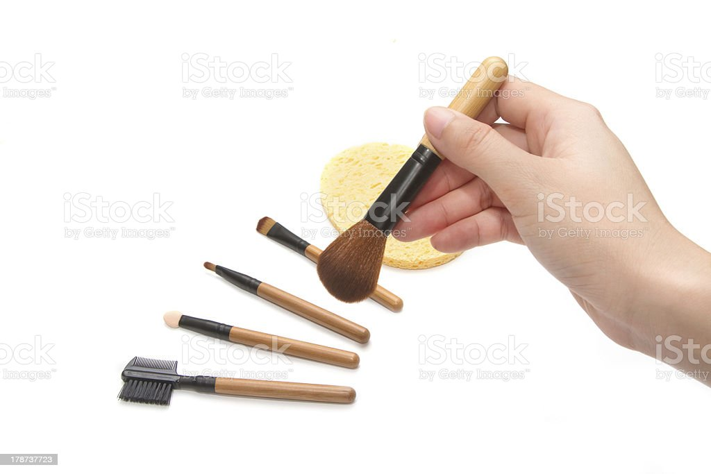 hand with set of  makeup brushes royalty-free stock photo
