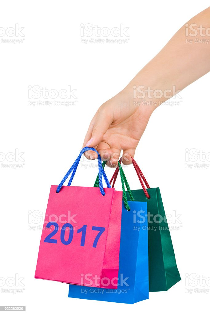 Hand with shopping bags 2017 stock photo