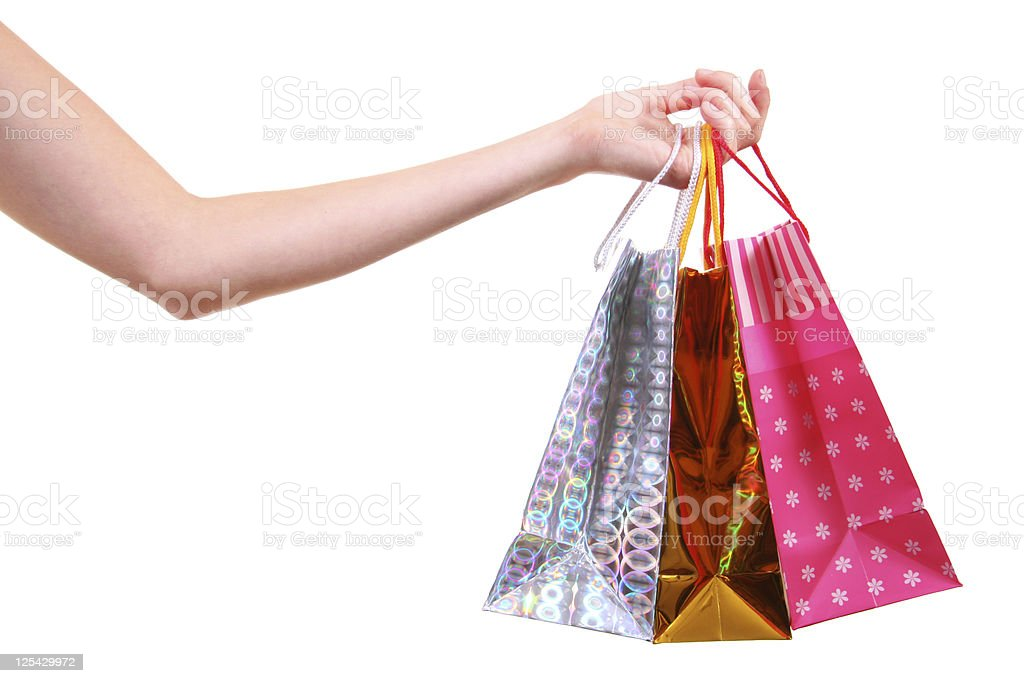 hand with shopping bags stock photo