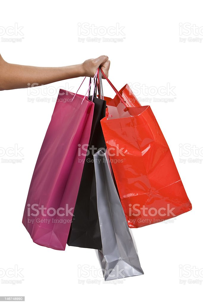 Hand with shopping bags royalty-free stock photo