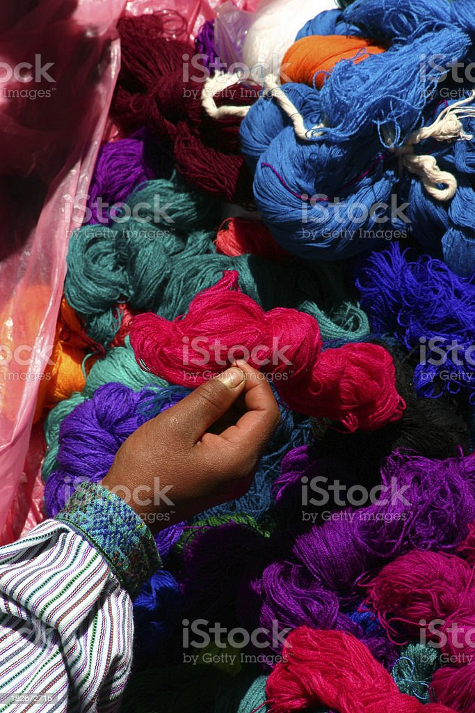 Hand with skeins of brightly colored yarn royalty-free stock photo